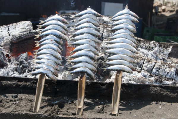 Open pit grilled sardines in Andalusia, Spain